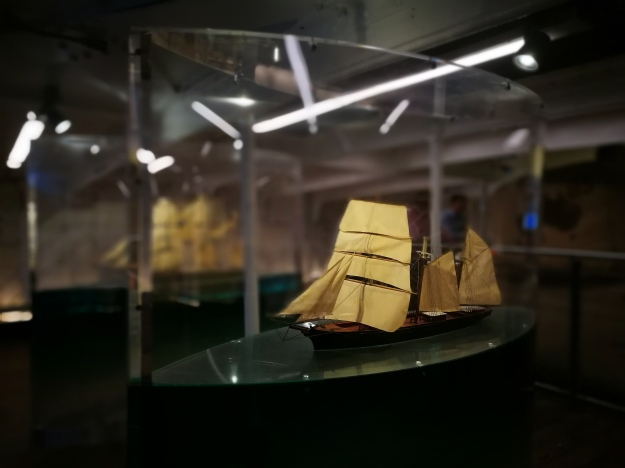 a model ship in a glass case