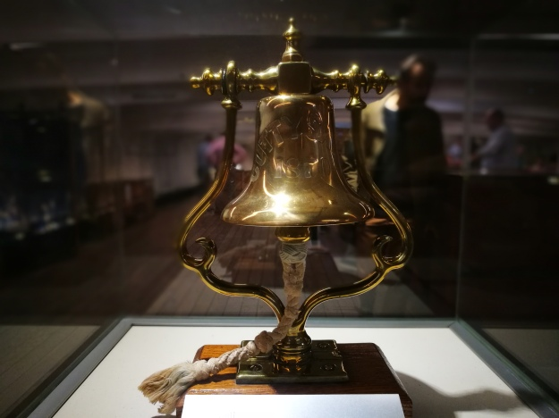 the original ship's bell in brass, engraved with