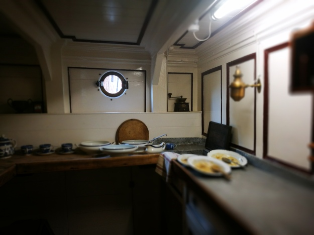 the original ship's galley filled with dirty plates and soup tureens