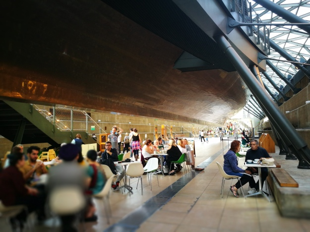the tearoom underneath the cutty sark ship's hull in a big modern gallery space