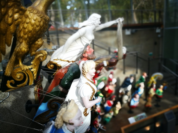 A number of carved figureheads from ships