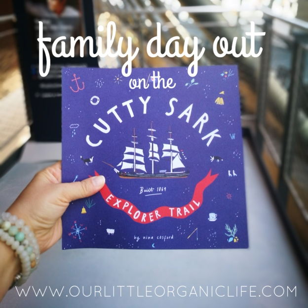family day out on the cutty sark explorer trail - photo of my hand holding out the brochure which doubles as a kid's guide to emboss at stamping stations throughout the ship