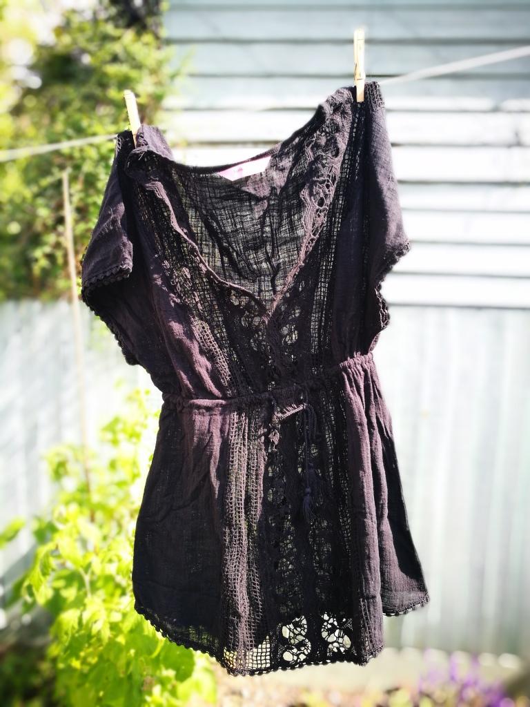Black Hunkemoller kaftan hanging on the clothing line.